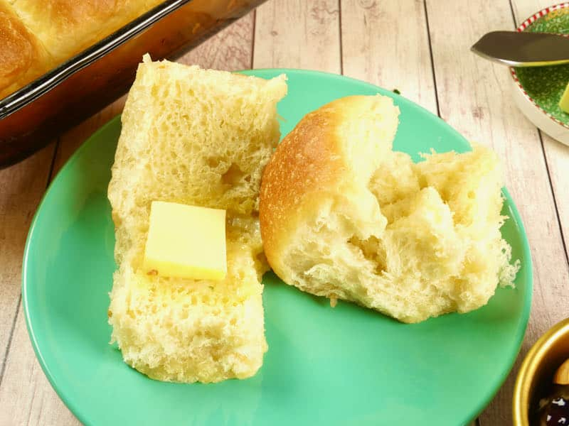 Homemade Potato Roll Recipe - Two slider sided buns opened to show off their fluffy interiors.